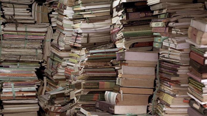 Stacks of books and magazines