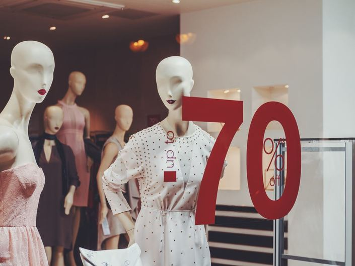 Store mannequin in window with 70% off sign